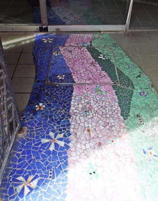 Mosaic tiled floor at the entrances to an event ticket office