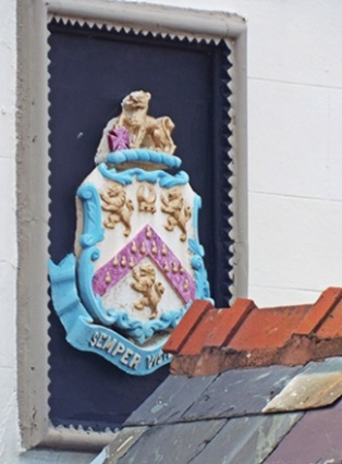 Coat of arms above the pub's porch
